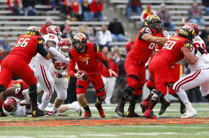 Maryland quarterback Caleb Rowe (7) rushes downfield in the first half of an NCAA college football game against Indiana, Saturday, Nov. 21, 2015, in College Park, Md.