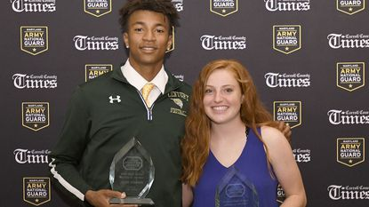 Athletes of the Year Jalen Stanton, left, of Century, and Erin Snyder, of Winters Mill, hold their trophies at the Carroll County Times High School Athlete of the Year Awards banquet at Martin's Westminster.