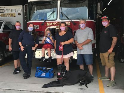 Peyton Waters, 6, donated food, masks, and water to the Manchester Volunteer Fire Company. She's pictured here with members of the department, from left, Scott Gross, Vanessa Kidd, Anna Greenwalt, Gary Eppley and Jeremy Sperlein, along with Elwood the dog.