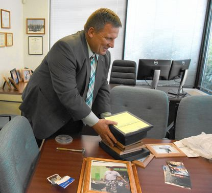 Edwin Singer, moving into his new office, is the new Health Officer for the Carroll County Health Department.