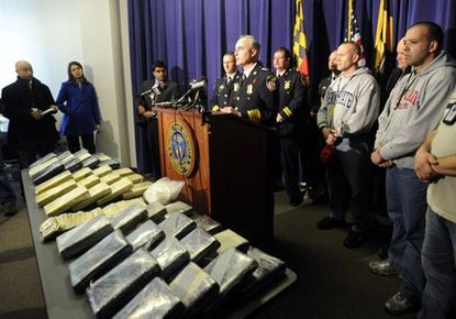 Police officials touted this 2009 dug bust. Former Baltimore police detective Ivo Louvado was sentenced Monday to 14 months in prison for lying to the FBI about stealing 7 pounds of cocaine from that same bust. Louvado is on the right, in the sweatshirt with red lettering.