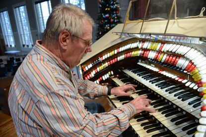 Buddy Boyd of Baltimore, president of The Free State Theatre Organ Society, plays the theater organ currently being restored at Spring Grove Hospital.