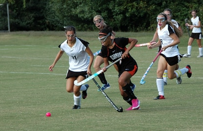 Mt. Hebron's Maria Packard (left) and Oakland Mills' Jordan Kerr race toward the ball during their game Friday afternoon that the Vikings won 8-1.