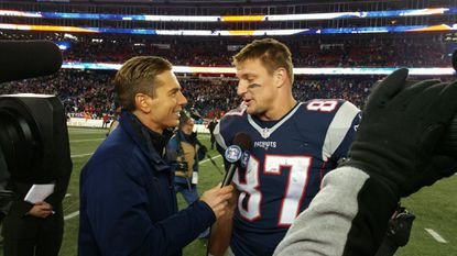 Pictured CBS Sports sideline reporter Evan Washburn interviewing Rob Gronkowski of the New England Patriots. Photo courtesy of CBS Sports.