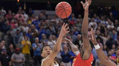 LSU guard Tremont Waters makes the game-winning shot as Maryland's Jalen Smith (25) defends during the second half in a second-round game in the NCAA men's college basketball tournament in Jacksonville, Fla., Saturday, March 23, 2019.