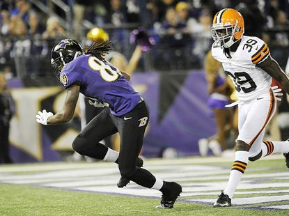 Torrey Smith scores a touchdown in front of Browns defensive back Tashaun Gipson during the first half of the Ravens' Thursday night game against the Cleveland Browns at M&T Bank Stadium in Baltimore Sept. 27, 2012.