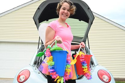 Judy Hemler of Finksburg shows off some pails filled with wine and other gifts as she prepares to make a drop for the Carroll County Wine Fairy group on Wednesday, May 20.