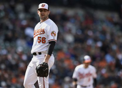 Darren O'Day stands on the mound after giving up two solo home runs to the Detroit Tigers in the eighth inning of a baseball game, Sunday, May 15, 2016, in Baltimore.