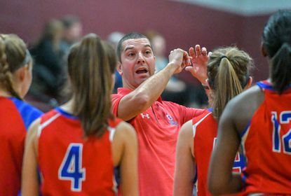 Centennial girls basketball coach Rob Slopek, pictured here in a game earlier this season, won his 100th career game in the Eagles' 58-43 win over Atholton on Friday, Feb. 7, 2020.