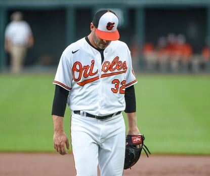 Baltimore Orioles starting pitcher Matt Harvey (32) walks back to the dugout at the end of the first inning.