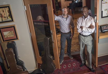 Bob Novak, left, and Terry Eberhardt own and operate Red Bridge Studios in Savage Mill.
