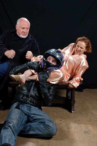 """Heather Bagnall, Eric Hufford (in motorcycle helmet) and Ken Sabel appear in """"Taking Steps,"""" a farce by Alan Ayckbourn running through June 29 at Colonial Players."""