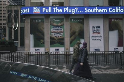 FILE -- An election coverage advertisement outside the Fox News headquarters in New York, Oct. 28, 2020. Dominion Voting Systems, an election technology company that was at the center of a baseless pro-Trump conspiracy about rigged voting machines, filed a lawsuit on March 26, 2021, that accused Fox News of advancing lies that devastated its reputation and business.
