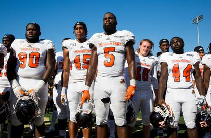 Morgan State football players listen to their school's band play their fight song following a game against Army on Saturday, Sept. 21, 2019 in West Point, N.Y.