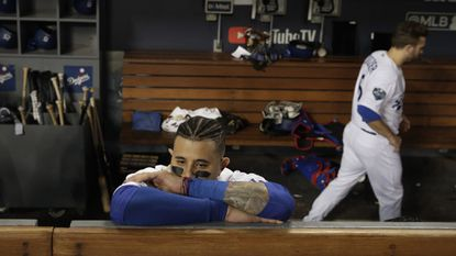 The Dodgers' Manny Machado stands in the dugout after Game 5 of the World Series against the Red Sox on Sunday, Oct. 28, 2018, in Los Angeles.