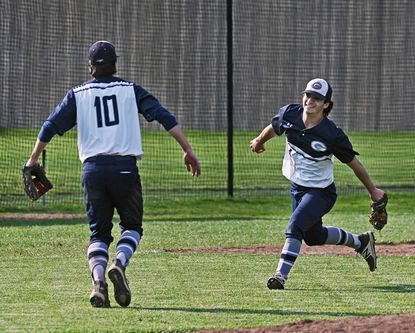 Gilman's Casey Bishop (#10), left, celebrates with Lucas Matanguihan after defeating Mount St. Joseph by score of 3 to 0 in MIAA baseball quarterfinals on May 17, 2021.
