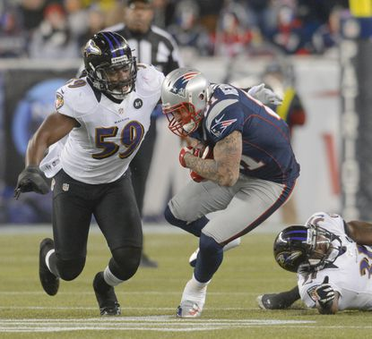 Ravens linebacker Dannell Ellerbe tackles New England Patriots tight end Aaron Hernandez in the AFC championship game in January.