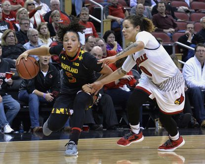 Maryland's Destiny Slocum (5) drives past the defense of Louisville' Briahanna Jackson (0) during the second half of an NCAA college basketball game, Thursday, Dec. 1, 2016, in Louisville, Ky. Maryland won 78-72.