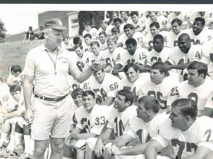 Maryland football coach Roy Lester greets some 90 candidates for the Terps football team which began fall practice Sept. 1, 1969, with a picture day on campus. (Paul Hutchins/Baltimore Sun)