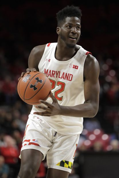 Maryland forward Makhel Mitchell looks to pass against Rhode Island during the first half of an NCAA college basketball game, Saturday, Nov. 9, 2019, in College Park, Md. (AP Photo/Julio Cortez)