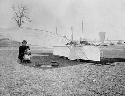 "By some accounts, Gustave Whitehead, seen here with his daughter and airplane ""No. 21,"" took flight on the aircraft in 1901."