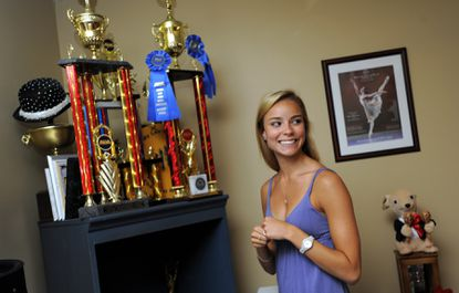 Rebecca Houseknecht, at her family's Odenton home, with some of the awards and prizes from her ballet career.