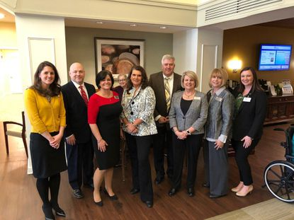 Pictured, from left, at the Copper Ridge reception, are Laurie Moyer; Rusty Mitchell, Copper Ridge executive director; Vicki Dedrick; Pamela Devito; Gary Ginter; Teresa Moore; Holly Schade; and Tracy Barnett, Copper Ridge director of neurocognitive supports. - Original Credit: Courtesy Photo