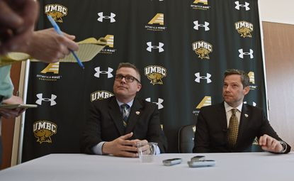 UMBC athletic director Tim Hall, left, and new men's basketball head coach Ryan Odom, right, conduct their first news conference after the introduction ceremony on campus.