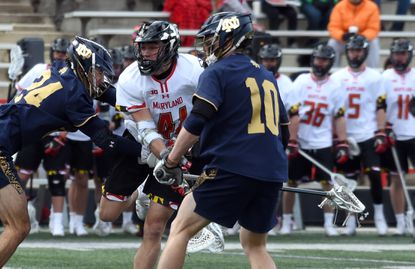 Center, Jack Brennan, Maryland, watches his shot as he scores in the second quarter of their Maryland men's lacrosse at Maryland Stadium. Notre Dame defenders are, left, John Hallenbeck and Jack Kielty. February 29, 2020.