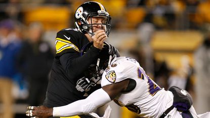 Ravens linebacker Courtney Upshaw, right, hits Pittsburgh Steelers quarterback Ben Roethlisberger during the Nov. 2 game.