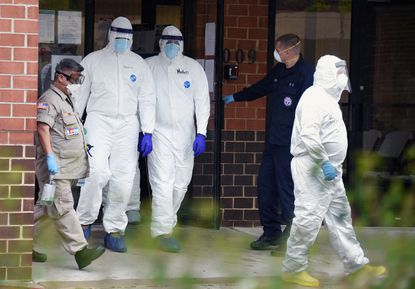 Plastic industry claims its products are essential for protective gear such as the suits worn by this disaster medical assistance team emerging from the Brinton Woods Post Acute Care Center in Baltimore last Friday afternoon. May 8, 2020