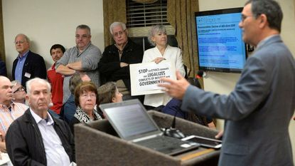 """Carroll County Commisioner Richard Rothschild addresses a capacity crowd attending his public presentation titled """"Faulty Ethics Ordinance"""" Tuesday before a meeting on the ethics ordinance in front of the full Board of Commissioners Feb. 27, 2018."""