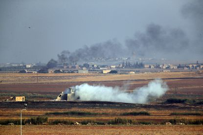 In this photograph taken in Akcakale, on the Turkish side of the border between Turkey and Syria, smoke billows from targets inside Syria during a bombardment by Turkish forces on Oct. 9, 2019. Turkey launched a military operation Wednesday against Kurdish fighters in northeastern Syria after U.S. forces pulled back from the area, with a series of airstrikes hitting a town on Syria's northern border.