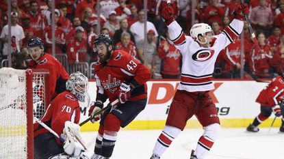 Brock McGinn of the Hurricanes scores the game winning goal against Braden Holtby (70) of the Capitals at 11:05 of the second overtime period in Game 7 of the Eastern Conference first round during the Stanley Cup playoffs at the Capital One Arena on April 24, 2019 in Washington.