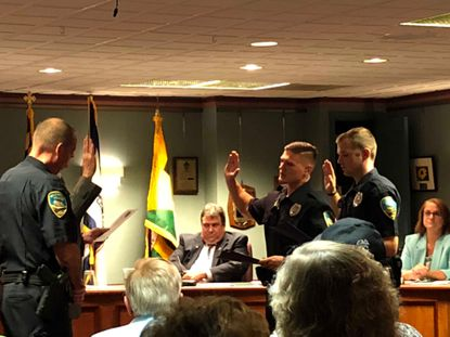 New Hampstead Police officers Matthew Baughman and Matthew Spencer are sworn in at the Hampstead Town Council meeting on Tuesday, Sept. 10.
