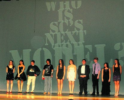 The contestants in the South Carroll's Next Top Model contest model their evening wear. From left: Nicole Centi, Carissa Cowman, Bryan Basham, Alec Boudreau, Kadie Corbin, Michaella Kuykendall, Darren Gable, Nick Matheson, Mary Reitz and Brittany Rude.