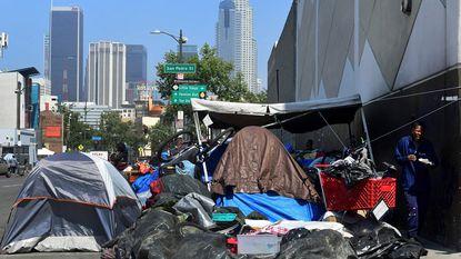 Belongings of the homeless crowd a downtown Los Angeles sidewalk in Skid Row in late May.