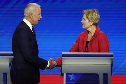 Former Vice President Joe Biden leads the Democratic primary race in Maryland, followed by U.S. Sen. Elizabeth Warren, according to a new poll from Goucher College. In this Sept. 12, 2019, file photo, Biden, left, and Warren shake hands after a debate in Houston.