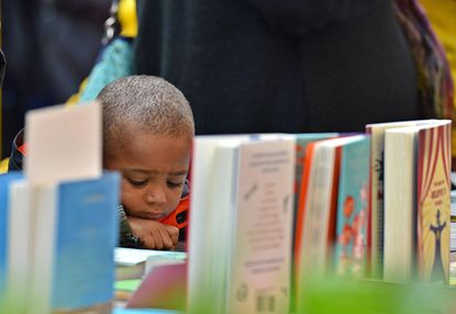 Ben West, 4, of Howard County, reviews a book during the annual Penguin Random House Book Fair at Carroll Community College on Saturday, March 5, 2016. The day included discounts on new book sales, book talks and signings, children's story time and a silent auction.