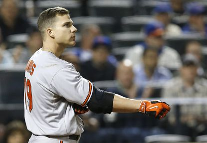 Orioles' Chris Davis reacts after stranding two runners on a strike out in the fifth inning against the New York Mets, Wednesday, May 6, 2015, in New York.