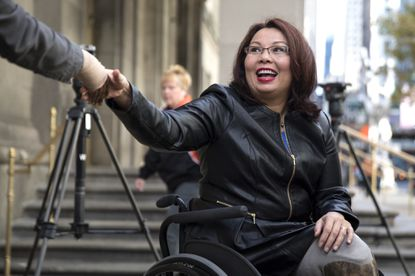 Then-U.S. Sen.-elect. Tammy Duckworth greets commuters outside the Millennium Park Metra Station in Chicago on Nov. 9, 2016, the day after she defeated Republican Mark Kirk.