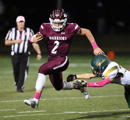 Havre de Grace's Brandon Rabbitt tries to slip away from North Harford's Kole Iddings on a carry during Friday night's Homecoming game against visiting North Harford.