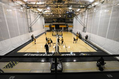 The Towson men's basketball team practices before the team's last scheduled home game.