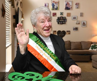 Thelma Graziano of Joppa, practices her parade wave style Wednesday afternoon. Graziano is a member of the Ladies Ancient Order of Hiberians and will be the Deputy Marshal for the Baltimore St. Patrick's Day parade.