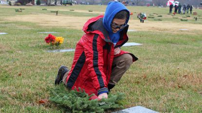 Brady Bowers, a member of Cub Scout Pack 853, lays a memorial wreath at the grave of Frank J. Brady, Army, at the Crownsville Veterans Cemetery on National Wreaths Across America Day on Dec. 15.