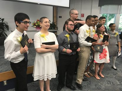 The 2019 Future Link students completing the certificate program say farewell during a ceremony Friday at Harford Community College.