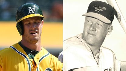 Boog Powell of the Oakland Athletics, left, and of the Orioles, right.