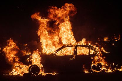 Flames from the Kincade Fire consume a car in the Jimtown community of unincorporated Sonoma County, Calif., on Thursday, Oct. 24, 2019. Wildfires are growing deadlier and more destructive amid climate change.