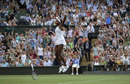 "Cori ""Coco"" Gauff celebrates after beating Slovenia's Polona Hercog in a Women's singles match during the Wimbledon championships in London, Friday, July 5, 2019."