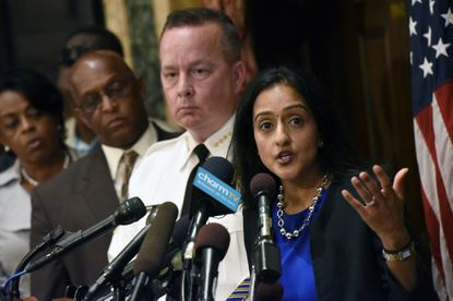 Vanita Gupta, right, of the U.S. Department of Justice talks about the findings of an investigation into the Baltimore Police Department as policeCommissioner Kevin Davis, City Council president Bernard C. Jack Young and Comptroller Joan Pratt listen during a news conference at City Hall.